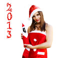 Christmas girl with champagne bottle Royalty Free Stock Photos