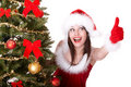 Christmas girl and fir tree with thumb up. Royalty Free Stock Photo