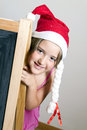 Christmas girl happy christma girls with red cap Stock Image