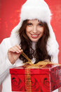 Christmas girl  holding a gift in packing Stock Photo
