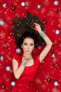 Christmas Girl Holding a Mistletoe and Blowing Kisses Royalty Free Stock Photo