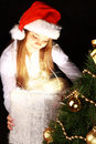 Christmas girl holding present over dark Stock Photography