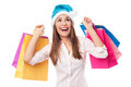 Christmas girl holding shopping bags young woman over white background Stock Image