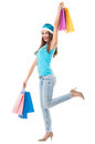 Christmas girl holding shopping bags young woman over white background Royalty Free Stock Image