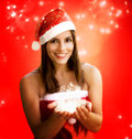 Christmas girl holding sparkling stars Stock Photo