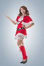 Christmas girl introduce smile happy asian isolated full length portrait Stock Photos