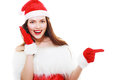 Christmas girl pointing isolated young beautiful to copyspace Stock Images