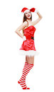 Christmas girl posing isolated young over white in striped stockings Stock Photography