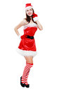 Christmas girl posing isolated young over white in striped stockings Royalty Free Stock Photography