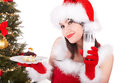 Christmas girl in santa hat and cake on plate red isolated Royalty Free Stock Images
