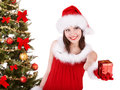 Christmas girl in santa hat giving gift box isolated Royalty Free Stock Images