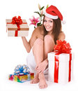 Christmas girl in santa hat, group gift box in spa Royalty Free Stock Photo