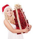 Christmas girl in santa hat holding  gift box. Stock Image