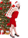 Christmas girl in santa hat holding red gift box. Royalty Free Stock Image