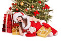 Christmas girl in santa hat holding red gift box isolated Royalty Free Stock Photo