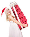 Christmas girl in santa hat holding stac gift box. Royalty Free Stock Image