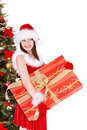Christmas girl in santa holding gift box. Stock Photos