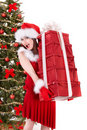 Christmas girl in santa holding stack gift box. Royalty Free Stock Photo