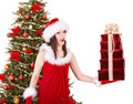 Christmas girl in santa holding stack gift box. Royalty Free Stock Photos