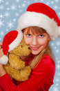 Christmas girl with teddy bear Stock Images