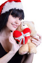 Christmas Girl with teddy bear on white Stock Image