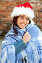 Christmas girl wrapped in blue blanket Royalty Free Stock Photos