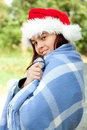 Christmas girl wrapped in blue blanket, outdoors Stock Image