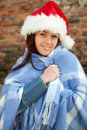 Christmas girl wrapped in blue blanket, outdoors Royalty Free Stock Image