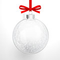 Christmas glass ball closeup with a red bow and snow Stock Image
