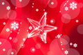 Christmas glass star on red ribbon Royalty Free Stock Images