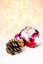 Christmas glowing bauble on a white snow with abstract christm bokeh background ornaments copy space for greeting Stock Images
