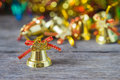 Christmas gold bells with bokeh decorations background. Royalty Free Stock Photo