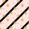 Christmas gold snowflake seamless pattern. Golden glitter snowflakes on pink black diagonal lines background. Winter Royalty Free Stock Photo