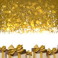 Christmas golden abstract background winter with gift boxes Royalty Free Stock Photo