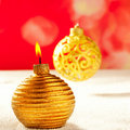 Christmas golden candle and bauble on snow Royalty Free Stock Images