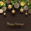 Christmas decoration and Christmas tree branches on a wooden background. Royalty Free Stock Photo