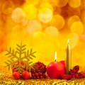 Christmas golden snowflake with red candles Stock Photo