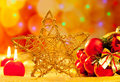 Christmas golden star candles and baubles Royalty Free Stock Photo