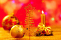 Christmas golden tree babubles and candles Stock Images