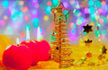 Christmas golden tree baubles and candles Royalty Free Stock Photography