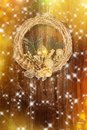 Christmas golden wreath on old abstract background Royalty Free Stock Photo