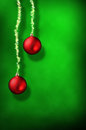 Christmas green background with red balls and ribbon stars verti Royalty Free Stock Photo