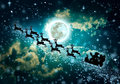 Christmas green background. Silhouette of Santa Claus flying on Royalty Free Stock Photo