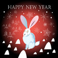 Christmas greeting card with a hare graphic on dark background snowflakes Stock Image