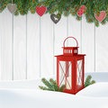 Christmas greeting card, invitation. Winter scene, red lantern with candle, Christmas tree branches, twigs. Wooden background. Royalty Free Stock Photo