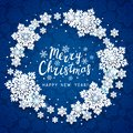 Christmas greeting card with paper snowflakes round frame on blue background for Your holiday design Royalty Free Stock Photo