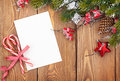 Christmas greeting card or photo frame over wooden table with sn Royalty Free Stock Photo