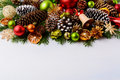 Christmas greeting card with pine cones and wooden jingle bell Royalty Free Stock Photo