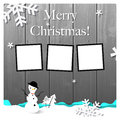 Christmas greeting card with snowman picture frames on wooden background Stock Images