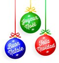 Christmas greeting ornaments illustration of colorful with lettered greetings in languages french italian and spanish Royalty Free Stock Images